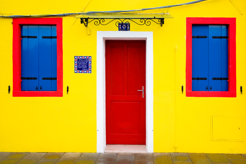 Door and windows in Burano, Italy - photograph by Jim Nilsen