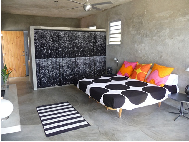 Donna's bedroom in Vieques property, reissued vintage Marimekko bedspread and her own pillow designs