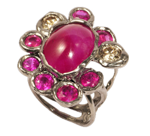 Black gold and ruby ring with diamonds by Luna Scamuzzi