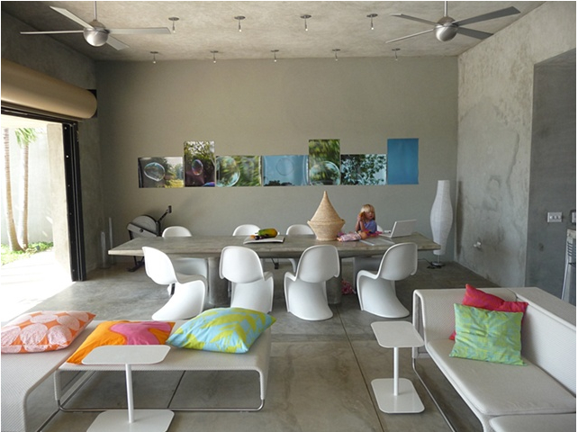 Donna's living room in Vieques property, her pillows in foreground and her photos on far wall