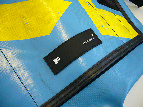 The 'Your Fault' label on a FREITAG bag